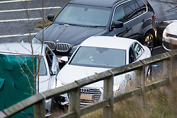 © Licensed to London News Pictures. 03/01/2017. Huddersfield UK. Picture shows bullet holes in the front window of a car at the scene where A a man has died during a pre-planned operation on a M62 slip road near Huddersfield. Police said a police firearm was discharged at about 18:00 on Monday near the M62 motorway.  Photo credit: Andrew McCaren/LNP