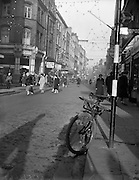 "12/12/1960<br /> 12/12/1960<br /> 12 December 1960<br /> View of Grafton Street, Dublin. Dublin without traffic. Lunchtime rush without the rush. Only traffic a carrier bicycle parked beneath a ""No waiting"" sign. Quiet streets owing to parking restrictions."