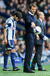 Caretaker Manager Tim Sherwood (ENG) of Tottenham Hotspur throws the ball as Manager Pepe Mel (ESP) of West Brom looks on behind - Photo mandatory by-line: Rogan Thomson/JMP - 07966 386802 - 12/04/2014 - SPORT - FOOTBALL - The Hawthorns Stadium - West Bromwich Albion v Tottenham Hotspur - Barclays Premier League.