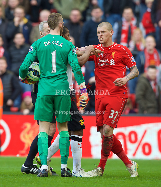 LIVERPOOL, ENGLAND - Sunday, March 22, 2015: Manchester United's goalkeeper David de Gea jumps up, from a supposed injury, to attack Liverpool's Martin Skrtel after the final whistle during the Premier League match at Anfield. (Pic by David Rawcliffe/Propaganda)