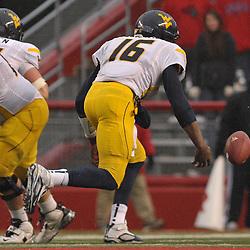Dec 5, 2009; Piscataway, NJ, USA; West Virginia quarterback Jarrett Brown (16) fumbles the ball during second half NCAA Big East college football action in West Virginia's 24-21 victory over Rutgers at Rutgers Stadium.