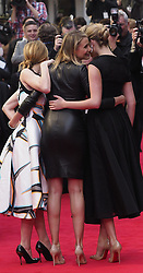 While being photographed US actress Cameron Diaz tells a joke to costar  Kate Upton , right, with Leslie Mann, left,as they arrive for the Premiere of their latest film, 'The Other Woman' in  London, United Kingdom. Wednesday, 2nd April 2014. Picture by Max Nash / i-Images
