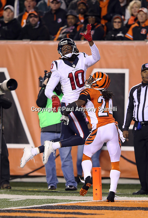 Houston Texans wide receiver DeAndre Hopkins (10) leaps and catches a one handed 22 yard touchdown pass for a 10-6 fourth quarter Texans lead while covered in the end zone by Cincinnati Bengals cornerback Adam Jones (24) during the 2015 week 10 regular season NFL football game against the Cincinnati Bengals on Monday, Nov. 16, 2015 in Cincinnati. The Texans won the game 10-6. (©Paul Anthony Spinelli)