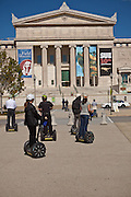Segway riders tour the Field Museum of Natural History in Chicago, IL, USA.