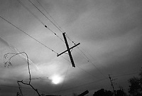A broken telephone pole hangs in the sky in the  lower ninth ward October 5, 2005 New Orleans Louisiana.  Nearly one month later and most of the New Orleans area is still in desperate conditions with little progress being made in the clean up and rebuilding of the city.     photo by darren hauck