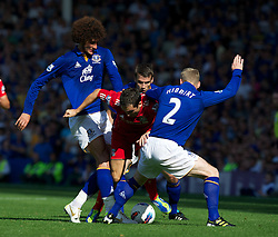 LIVERPOOL, ENGLAND - Saturday, October 1, 2011: Liverpool's Stewart Downing in action against Everton's Marouane Fellaini during the Premiership match at Goodison Park. (Pic by David Rawcliffe/Propaganda)