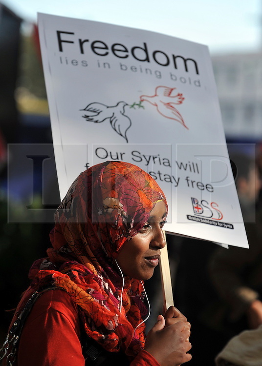 "35559258© Licensed to London News Pictures. 29/10/2011. London, UK.  A young girl carries a banner calling for freedom. Amnesty International join Syrians in the UK for a ""N0 More Blood - No More Fear"" march and rally in Paddington Green, London, today 29th October 2011. Activists claim  Syrian security forces opened fire on Friday on protesters and hunted them down in house-to-house raids, killing about 40 people in the deadliest day in weeks in the country's 7-month-old uprising. Photo: Stephen Simpson/LNP"