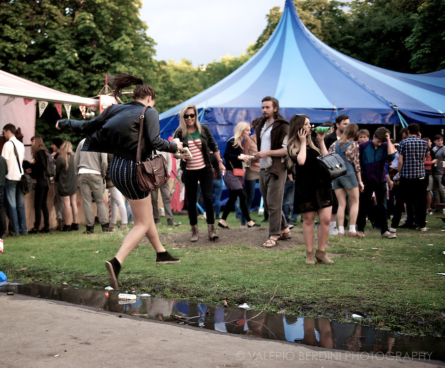 Jumping a puddle after a summer shower. Field Day Festival, London 2011.