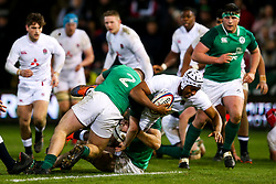 Chunya Munga of England U20 is tackled by John McKee of Ireland U20 - Rogan/JMP - 21/02/2020 - Franklin's Gardens - Northampton, England - England U20 v Ireland U20 - Under 20 Six Nations.
