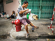 30 AUGUST 2016 - BANGKOK, THAILAND: A man eats a bowl of noodles while he waits for a family member getting food and clothing in the Poh Teck Tung Shrine on the last day of Hungry Ghost Month in Bangkok. Chinese temples and shrines in the Thai capital host food distribution events during Hungry Ghost Month, during the 7th lunar month, which is usually August in the Gregorian calendar.        PHOTO BY JACK KURTZ