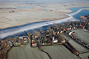 Nederland, Noord-Holland, Holysloot, 10-01-2009; schaatsers op de bevroren Holysloter Die met de polder De Belmermeer, gezien naar Zuiderwoude, klassiek Hollands Winterlandschap; skaters on frozen lake - polder landscape immediately north of Amsterdam  - during skating tour, classical winter landscape; Holysloot, Holiesloot, Zuiderwou; schaats, schaatsen, ijs, ijspret, pret, ijsbaan, natuurijs, schaatsen rijden, winter, koud, vriezen, min nul, beneden nul, onder nul, gevoelstemperatuur, windchill, koud, celsius, skating, ice skating, ice, fun, skating rink, natural, skate, snow, cold, freezing, minus zero, below zero, cold, winterlandschap, winter landscape, tocht, toertocht, koek en zopie . .luchtfoto (toeslag); aerial photo (additional fee required); .foto Siebe Swart / photo Siebe Swart