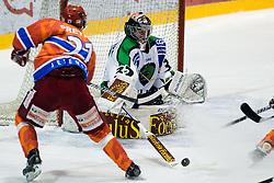 Jan Chabera (HDD Tilia Olimpija, #32) pokes a puck in front of Klemen Pretnar (HK Acroni Jesenice, #21) during ice-hockey match between HK Acroni Jesenice and HDD Tilia Olimpija in 50th Round of EBEL league, on Februar 15, 2011 at Dvorana Podmezaklja, Jesenice, Slovenia. (Photo By Matic Klansek Velej / Sportida.com)