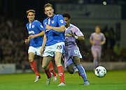 Matt Clarke denies Garath McCleary during the Capital One Cup match between Portsmouth and Reading at Fratton Park, Portsmouth, England on 25 August 2015. Photo by Adam Rivers.