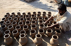 A Pakistani man arranges pottery at a workshop in southern Pakistani port city of Karachi, Feb. 25, 2015. EXPA Pictures © 2015, PhotoCredit: EXPA/ Photoshot/ Arshad<br /> <br /> *****ATTENTION - for AUT, SLO, CRO, SRB, BIH, MAZ only*****