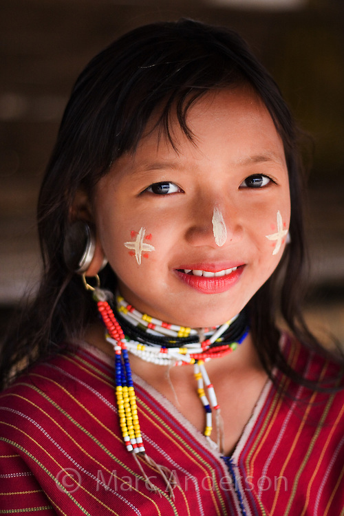 Young girl from the Karen hill tribe wearing traditional clothes and face markings, Tha Ton, Chiang Mai Province, Thailand
