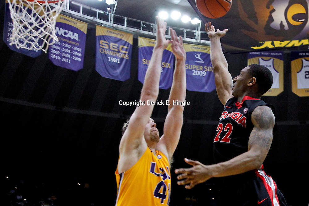 February 22, 2012; Baton Rouge, LA; Georgia Bulldogs guard Gerald Robinson (22) shoots over LSU Tigers center Justin Hamilton (41) during the second half of a game at the Pete Maravich Assembly Center. LSU defeated Georgia 61-53. Mandatory Credit: Derick E. Hingle-US PRESSWIRE