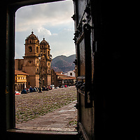 The Church of the Society of Jesus is located in Cusco, Peru's city square called Plaza de Armas.  It is an example of Andean Baroque architecture and was built on the site of an Inca palace.