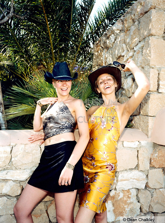 Two girls posing for the camera wearing cowboy hats in Ibiza 1999