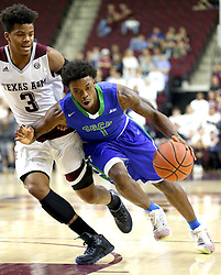 Florida Gulf Coast University's Reggie Reid (1) drives the lane against Texas A&M's Admon Gilder (3) during a NCAA college basketball game in College Station, Texas, Wednesday, Dec. 2, 2015.  (AP Photo/Sam Craft)