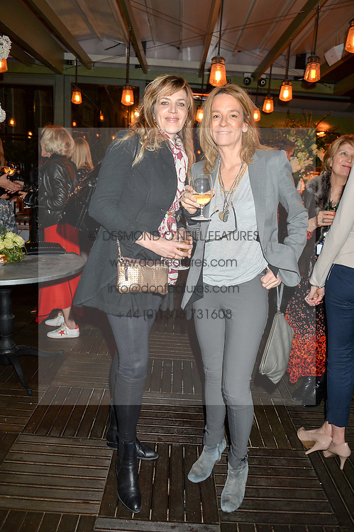 Left to right, MARTHA FIENNES and GEORGIA BYNG at The Ivy Kensington Brasserie International Women's Day & Terrace Launch Party held at The Ivy Kensington Brasserie, 96 Kensington High Street, London on 8th March 2016.