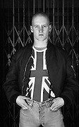 Skinhead man wearing Union Jack shirt, High Wycombe, UK, 1980s.