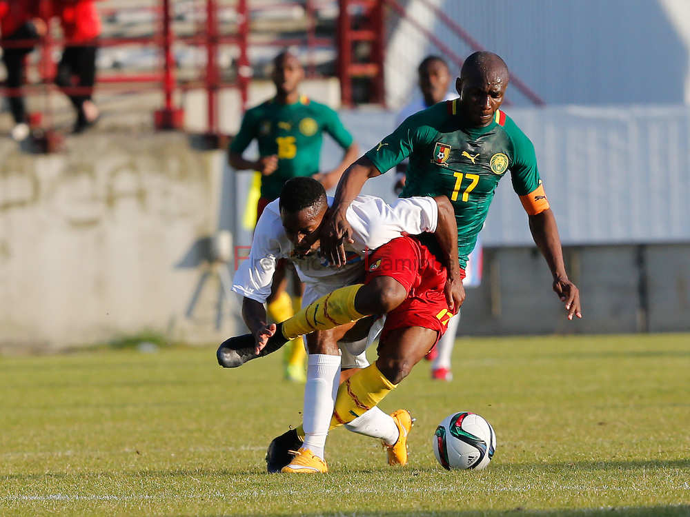 20150609 - Mons, Belgium : DR Congo's forward Cédric BAKAMBU (#9) and Cameroun's center Stéphane MBIA (#17) fight for the ball during the friendly football game between Democratic Replublic of Congo and Cameroun on 09/06/2015 in Mons (Albert)