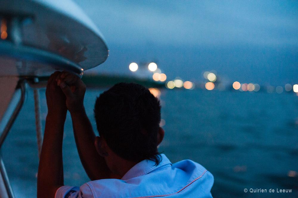 Java Sea  at evening and lights of Jakarta city