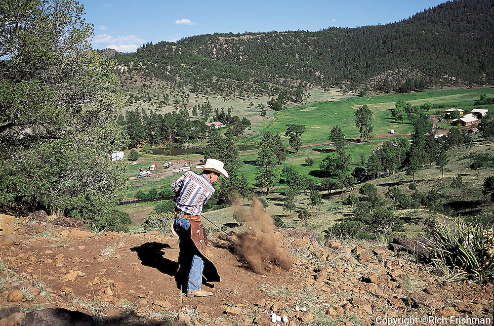 Photograph of Cowboy Golf in Springerville, Arizona USA. The players ride horses between holes at the cowboy golf tournament in Springerville, Arizona..Cowboy Golf: View of cowboy in action, shot at South Fork Canyon. Springerville, AZ 6/9/2001......