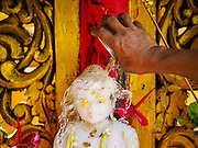 18 NOVEMBER 2017 - YANGON, MYANMAR: A man pours scented water over a statue of the Buddha at Sule Pagoda in central Yangon. Pope Francis is visiting Myanmar, September 27-30. It will be the first visit by a Pope to the overwhelmingly Buddhist nation. He will meet with the Aung San Suu Kyi and other political leaders and will participate in two masses in Yangon. The Pope is expected to talk about Rohingya issue while he is in Myanmar. The Rohingya are persecuted Muslim minority in Rakhine state in western Myanmar. It's not clear how Myanmar's politically powerful nationalist monks will react if the Pope openly talks about the Rohingya. In the past, the monks have led marches and demonstrations against foreign diplomatic missions when foreign ambassadors have spoken in defense of the Rohingya. There is not much visible sign of the Pope's imminent visit in Yangon, which is estimated to be more than 90% Buddhist.    PHOTO BY JACK KURTZ