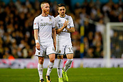 Leeds United midfielder Adam Forshaw (4) and Leeds United midfielder Pablo Hernandez (19)  during the EFL Sky Bet Championship match between Leeds United and Brentford at Elland Road, Leeds, England on 21 August 2019.