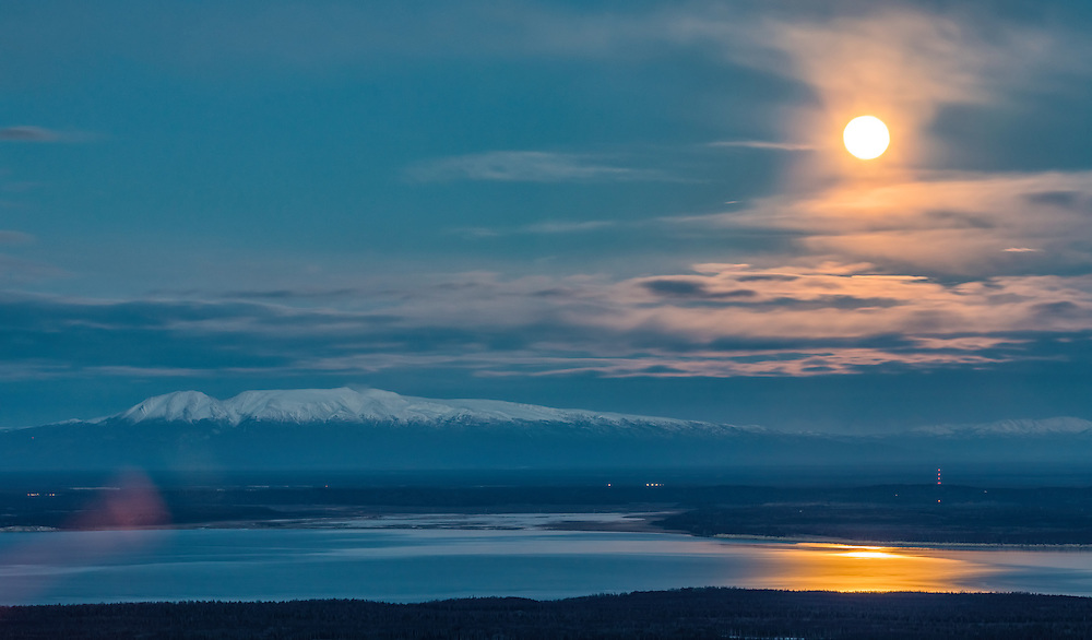Setting supermoon overlooks Mt. Susitna (Sleeping Lady) and the Knik Arm in Southcentral Alaska. Autumn. Morning.