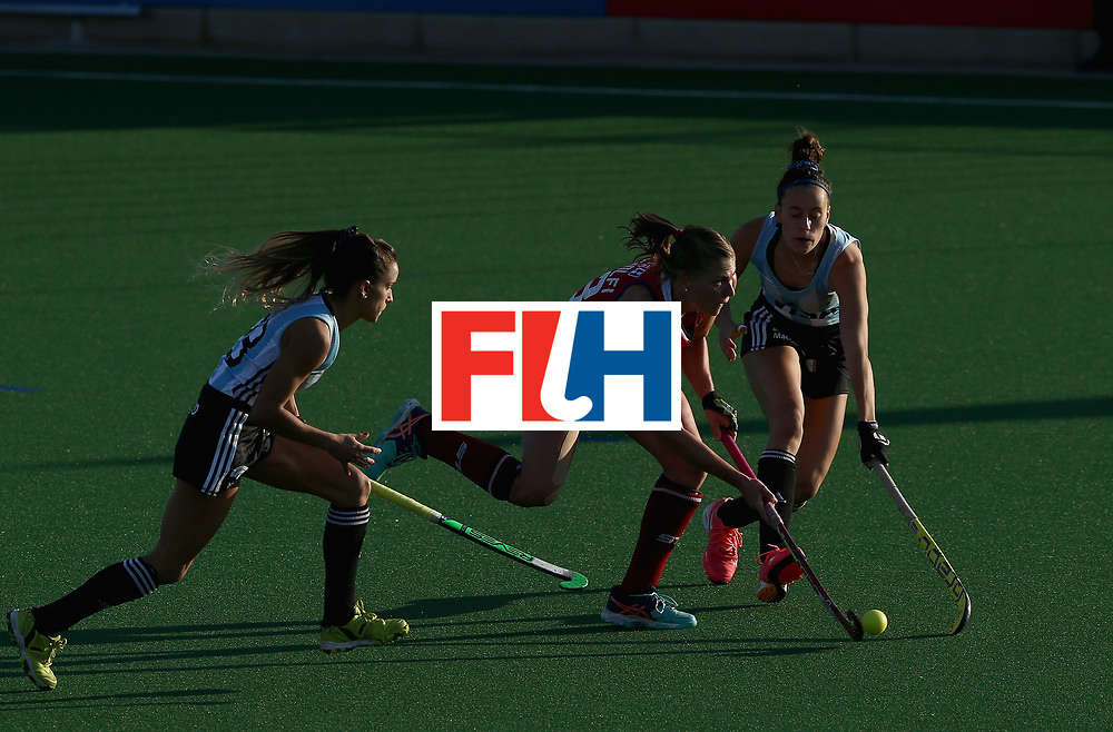 JOHANNESBURG, SOUTH AFRICA - JULY 14: Katelyn Ginolfi of the United States and Maria Campoy of Argentina battle for possession during day 4 of the FIH Hockey World League Semi Finals Pool B match between the United States and Argentina at Wits University on July 14, 2017 in Johannesburg, South Africa. (Photo by Jan Kruger/Getty Images for FIH)