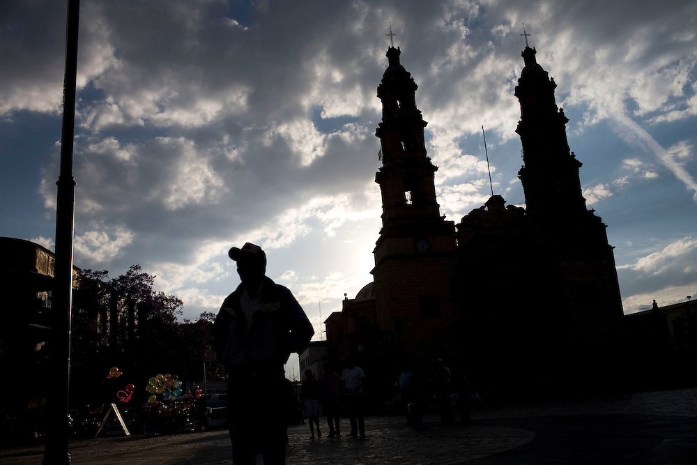 A man stands in front of a cathedral in downtown Aguascalientes.