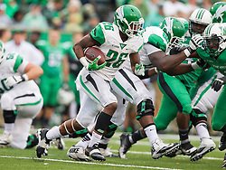Oct 24, 2015; Huntington, WV, USA; North Texas Mean Green running back Jeffrey Wilson runs the ball against the Marshall Thundering Herd during the second quarter at Joan C. Edwards Stadium. Mandatory Credit: Ben Queen-USA TODAY Sports