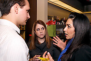 (from left) Jason Burris of Burris & Co. CPAs, Krystle Marko of Utrecht & Young and Maha Kashani of Cincinnati Bell during the Generation Dayton annual holiday wine tasting at Winan's Chocolates and Coffees near the Dayton Mall in Miami Township, Thursday, December 1, 2011.