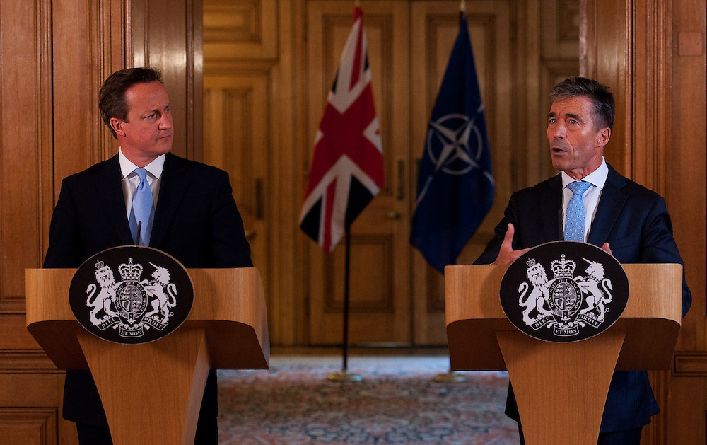British Prime Minister David Cameron, (left), and NATO Secretary General Anders Fogh Rasmussen (right)  speak to journalists during a joint press conference in 10 Downing Street in London, 19 June, 2014. EPA/WILL OLIVER/INTERNATIONAL POOL