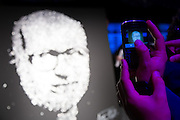 "A man photographs a ""light painting"" portrait with his smartphone during the inaugural party for the new Paris headquarters of the Ludendo toy group.<br /> Paris, France.<br /> Client: Withup"