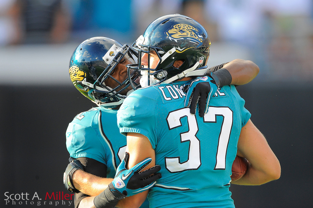 Jacksonville Jaguars cornerback Don Carey (22) and safety Sean Considine (37) celebrate  Considine's game ending ineterception during the Jgas 24-20 win over the Cleveland Browns at EverBank Field on Nov. 21, 2010 in Jacksonville, Florida. ..©2010 Scott A. Miller