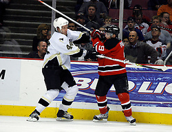 Mar 14, 2007; East Rutherford, NJ, USA;  Pittsburgh Penguins defenseman Brooks Orpik (44) and New Jersey Devils left wing Zach Parise (9) shove each other during the third period at Continental Airlines Arena in East Rutherford, NJ. Mandatory Credit: Ed Mulholland-US PRESSWIRE Copyright © 2007 Ed Mulholland
