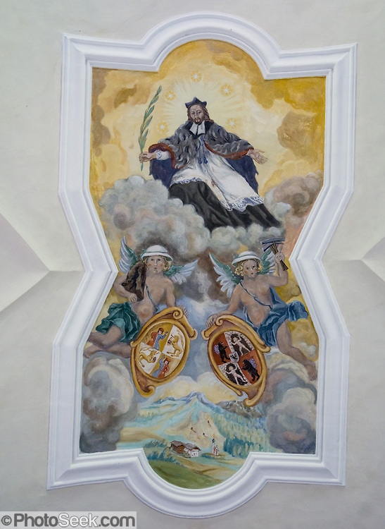 Ceiling painting, St. Johann in Ranui, Val di Funes (Villnöss valley), Dolomites, Italy, Europe. The Baroque, onion-domed Church of St. Johann in Ranui was built in 1744 and dedicated to Saint Johannes Nepomuk. John of Nepomuk, or Nepomucenea, is a national saint of the Czech Republic, the first martyr of the Seal of the Confessional, a patron against calumnies, and a protector from floods. The Dolomites are part of the Southern Limestone Alps, Europe. UNESCO honored the Dolomites as a natural World Heritage Site in 2009.