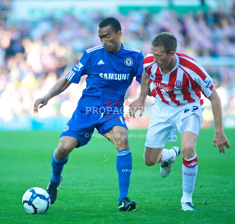 STOKE, ENGLAND - Saturday, September 12, 2009: Chelsea's Jose Bosingwa (left) and Stoke City's Danny Collins (right) during the Premiership match at the Britannia Stadium. (Pic by Gareth Davies/Propaganda)