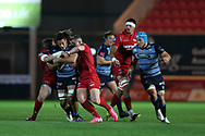 Josh Navidi of Cardiff Blues &copy; is stopped by Hadleigh Parkes (l) and Scott Williams &reg; of the Scarlets. Guinness Pro14 rugby match, Scarlets v Cardiff Blues  at the Parc y Scarlets in Llanelli, West Wales on Saturday 28th October 2017.<br /> pic by  Andrew Orchard, Andrew Orchard sports photography.