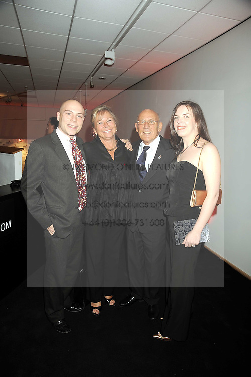 SIR STIRLING & LADY MOSS with his children ELLIOT MOSS and HELEN MOSS at the TAG Heuer British Formula 1 Party at the Mall Galleries, London on 15th September 2008.