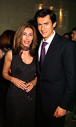 MISS LOULOU HAINSWORTH and her close friend MR GEOFFREY MOORE son of actor Roger Moore, at a party in London on 8th November 1999.MYS 45