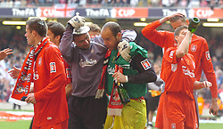 CARDIFF, WALES - SATURDAY, MAY 13th, 2006: Liverpool's goalkeepers Jerzy Dudek and Jose Reina share a joke after the FA Cup Final victory against West Ham United at the Millennium Stadium. (Pic by Jason Roberts/Propaganda)