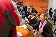 Kelly Dunnigan sells tickets before the annual Pink the Rink game between Pittsford and McQuaid at RIT's Gene Polisseni Center in Henrietta on Saturday, February 4, 2017.