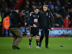 Bournemouth Manager Eddie Howe makes his way off the pitch with Harry Arter of Bournemouth - Mandatory byline: Alex James/JMP - 12/12/2015 - Football - Vitality Stadium - Bournemouth, England - AFC Bournemouth v Manchester United - Barclays Premier League