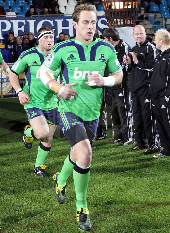 Jimmy Cowan trots on to the field in the new green Highlanders jersey..Investec Super Rugby - Highlanders v Force, 3 June 2011, Carisbrook Stadium, Dunedin, New Zealand..Photo: Rob Jefferies / www.photosport.co.nz