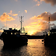 Fishing boats at New Quay in the sunrise.<br />