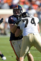 Virginia defensive end Chris Long (91) takes on Wake Forest center Steve Justice (74).  The #23 Virginia Cavaliers defeated the #24 Wake Forest Demon Deacons 17-16 at Scott Stadium in Charlottesville, VA on November 3, 2007.
